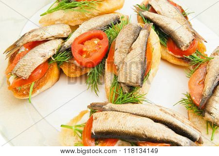 Some Sandwiches With Sprats On A Dish
