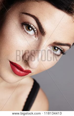 Woman's Face Closeup . Red Lips
