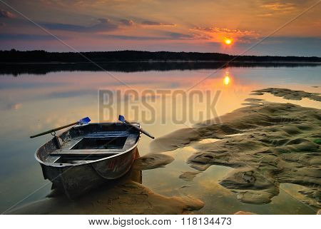 Sand Moored Boat On Sunrise