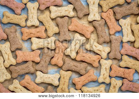milk bones (dog treats) in a variety of flavors - background on wood