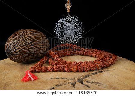 Indian Art - Mandala And Prayer Beards From Rudraksha On Teak Wood And Black Background