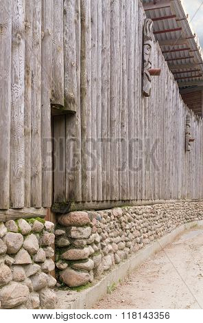 Fence From Logs On Stone Base