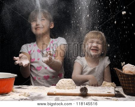Children playing with flour