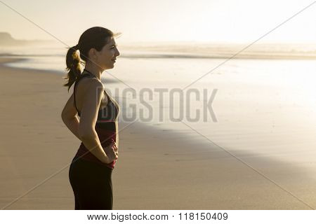 Shoot of a beautiful woman relaxing at the beach after exercise