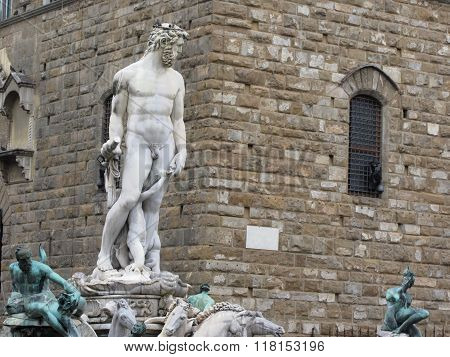 The Neptune Fountain And Palazzo Vecchio In Florence, Italy . Detail Of The Neptune Statue .