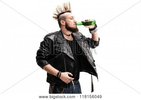 Studio shot of a young male punk rocker holding a cigarette and drinking a beer isolated on white background