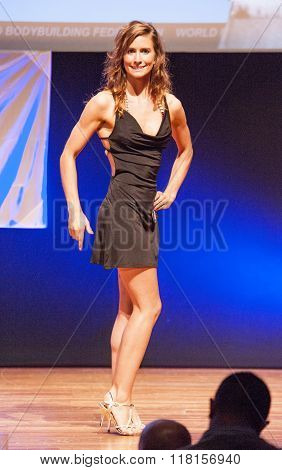 Female Figure Model In Evening Dress Shows Her Best