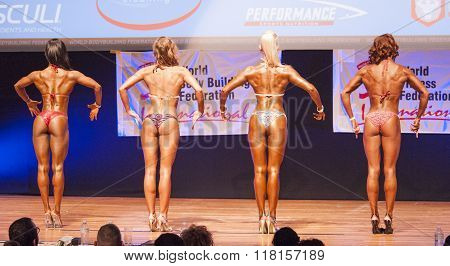 Female Figure Model Shows Her Best At Championship On Stage