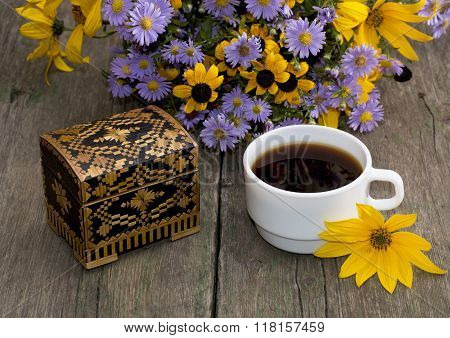 Coffee, Casket And Bouquet Of Beautiful Wild Flowers, On A Wooden Table