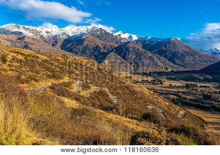 Valley view from Crown Range road New Zealand. Scenic valley view from Crown Range road Queenstown New Zealand. Winding mountain road. Beautiful mountain landscape