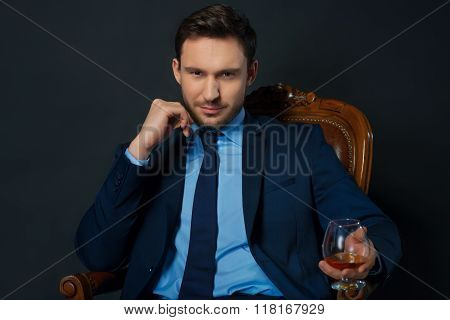 Handsome businessman drinking alcohol