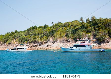 Cruise boats with tourists off the island in the Andaman Sea, Thailand