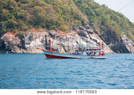 Small fishing trawler off the island in the Andaman Sea, Thailand
