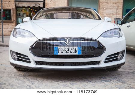 White Tesla Model S Car Parked On Urban Roadside