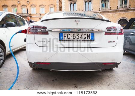 White Tesla Model S Car Charging