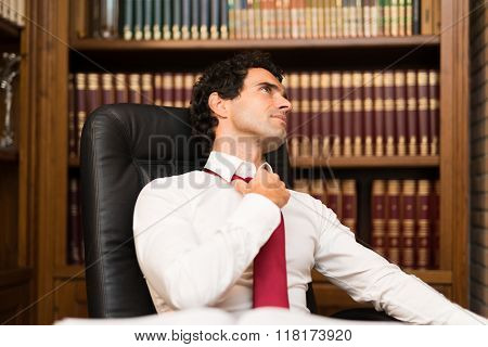 Mature man relaxing in his office after work