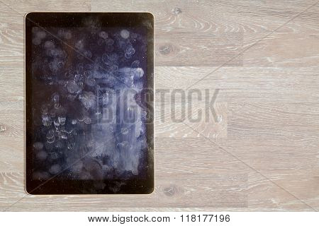 View Of Fingerprints And Grease On Tablet Screen