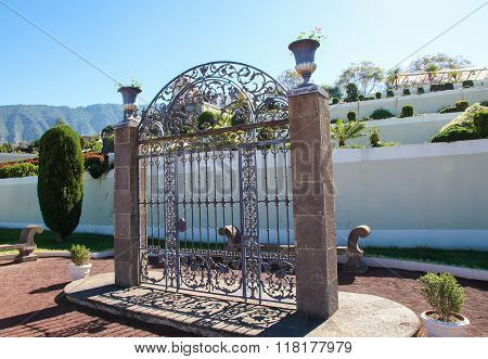 Wrought iron gate in the Jardines Marquesado de la Quinta Roja in La Orotava Tenerife Spain