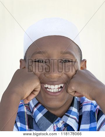 Portrait of a joyful Muslim boy, ten years old