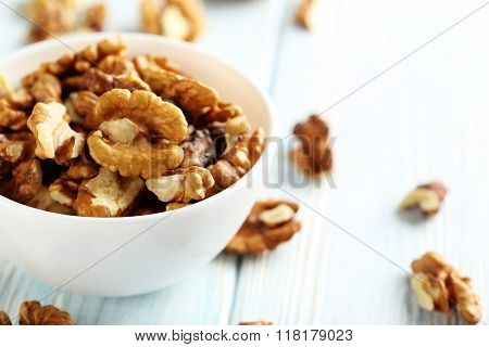 Walnut On A Blue Wooden Table