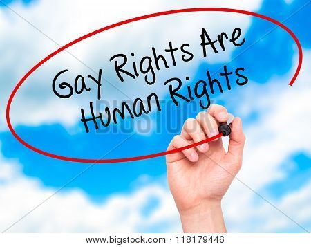 Man Hand Writing Gay Rights Are Human Rights  With Black Marker On Visual Screen