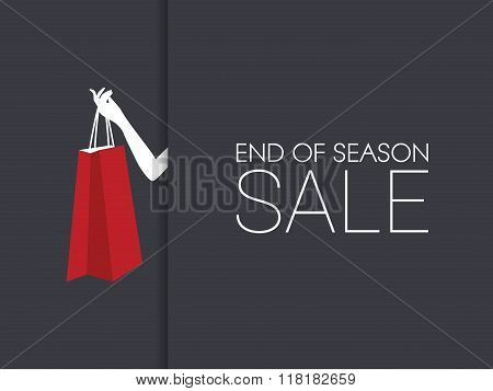 End of season sale banner with hand holding shopping bag and black background.