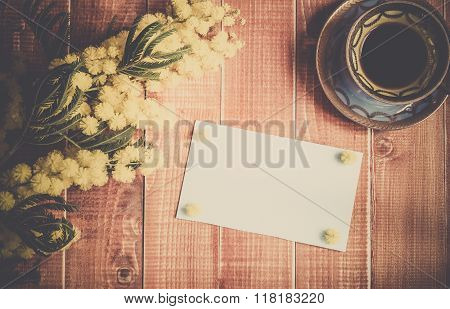 Empty card with mimosa and coffee