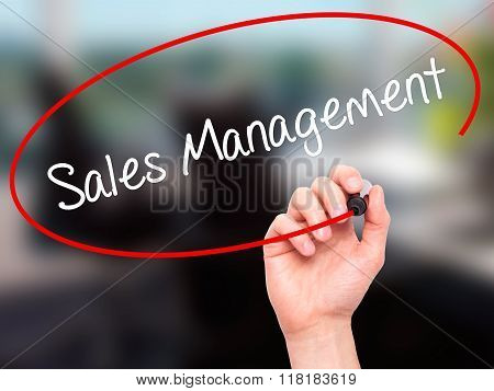 Man Hand Writing Sales Management With Black Marker On Visual Screen