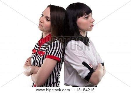 Two young brunette women back-to-back