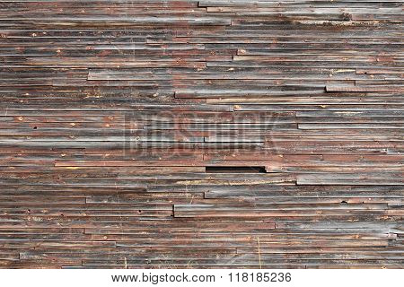 old motley woodern wall texture of small boards