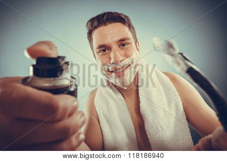 Handsome Man With Shaving Cream Foam Can And Razor