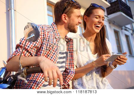 Couple in town using smartphone