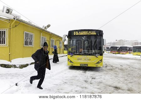 People And Yellow Public Bus On A Snowy Winter Day