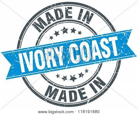 made in Ivory Coast blue round vintage stamp