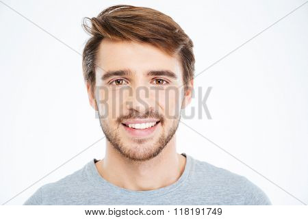 Closeup portrait of a smiling man looking at camera isolated on a white background