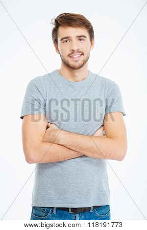 Happy casual man standing with arms folded isolated on a white background