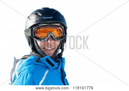 Smiling man in the blue skiing jacket, helmet and glasses against white background