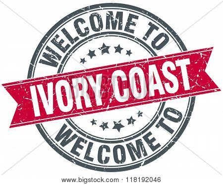 welcome to Ivory Coast red round vintage stamp