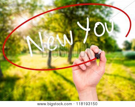 Man Hand Writing New You With Black Marker On Visual Screen