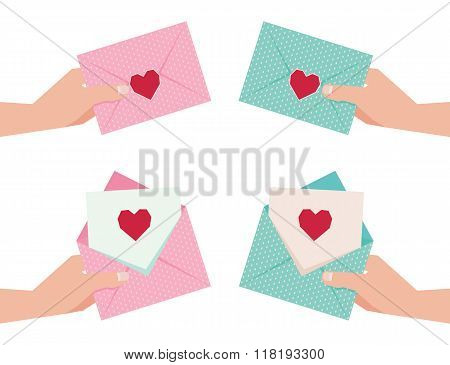 Hand Giving An Envelope With Valentine Card
