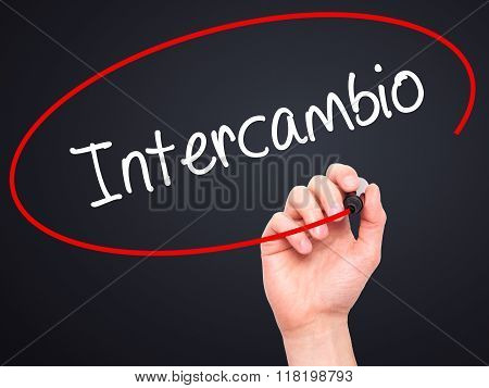 "Man Hand Writing ""intercambio"" (in Portuguese - Student Exchange Program)  With Black Mark"
