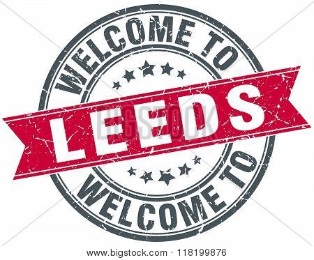 welcome to Leeds red round vintage stamp