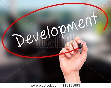 Man Hand Writing Development With Black Marker On Visual Screen