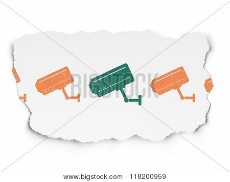 Privacy concept: cctv camera icon on Torn Paper background