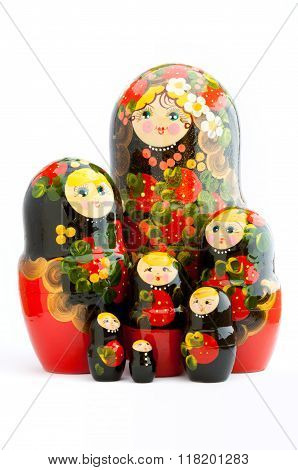Seven traditional Russian matryoshka dolls on white background