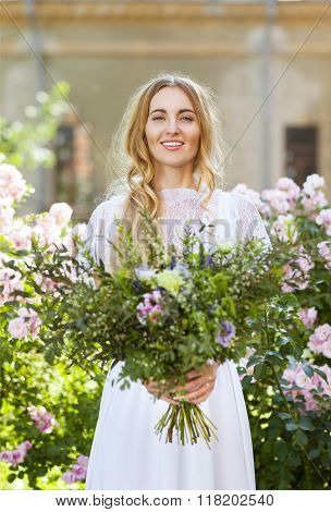 Bride With Beautiful Wedding Bouquet Of Flowers In The Style Of Boho