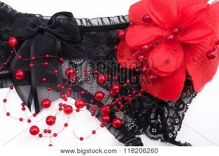 Black garter belt and red flower