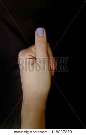 Woman's hand doing  thumbs up