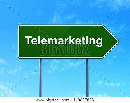 Marketing concept: Telemarketing on road sign background