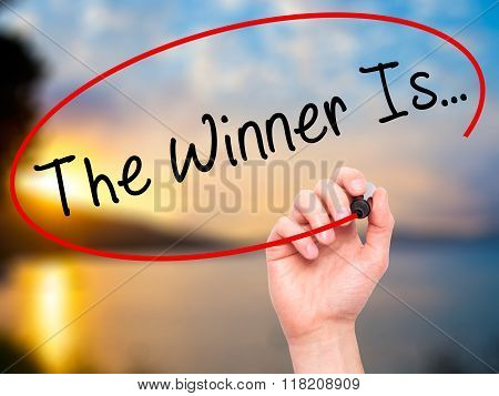 Man Hand Writing The Winner Is